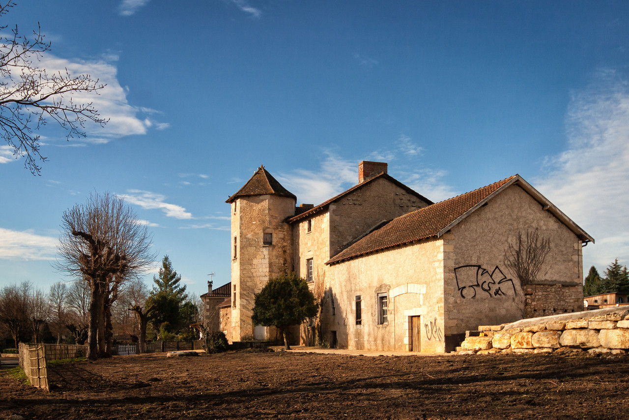 An old farm with a graffiti in Perigueux, France.