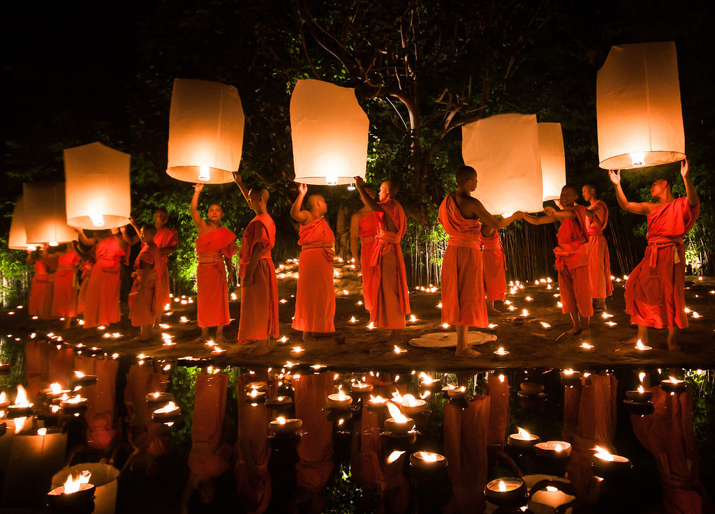 Monks lighting lanterns during Loy Krathong in Chiang Mai, Thailand