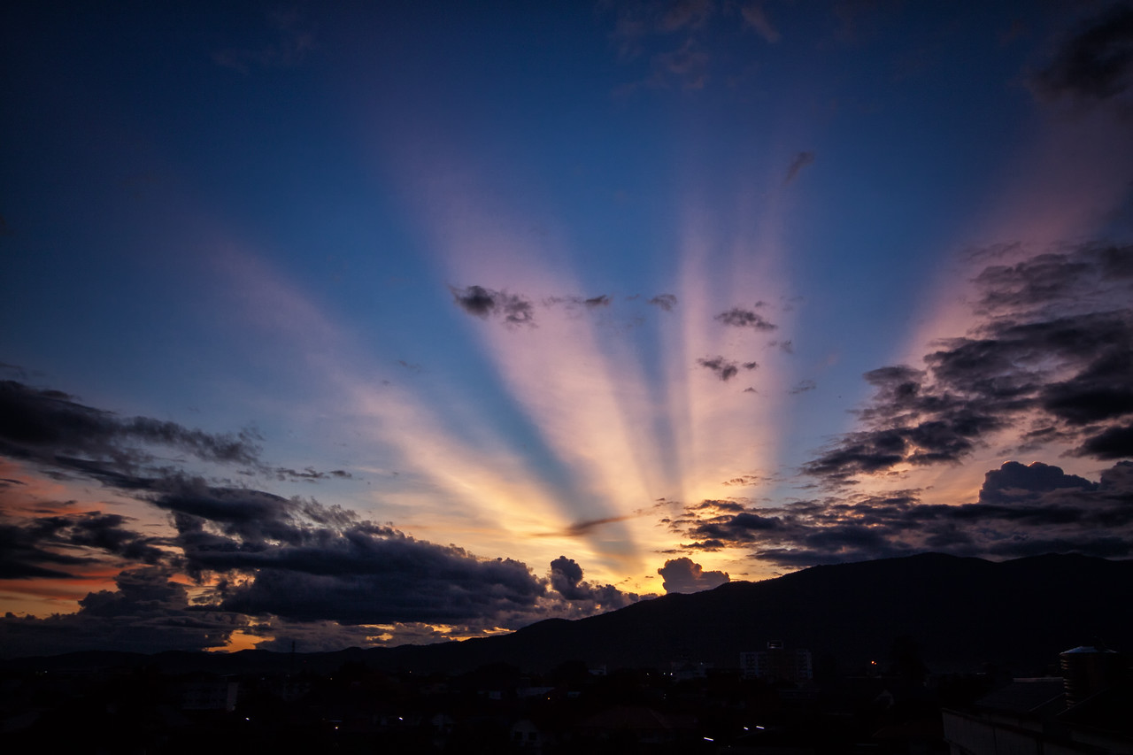 Sun rays from behind Doi Suthep mountain in Chiang Mai, Thailand