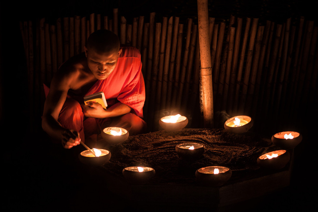 Candle meditation in a temple in Chiang Mai, Thailand