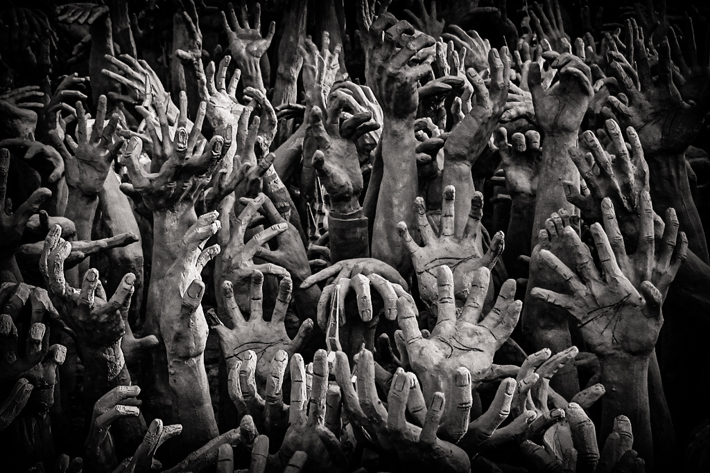 Hands reaching out from Hell at the entrance of the White Temple Wat Rong Khun in Chiang Rai, Thailand