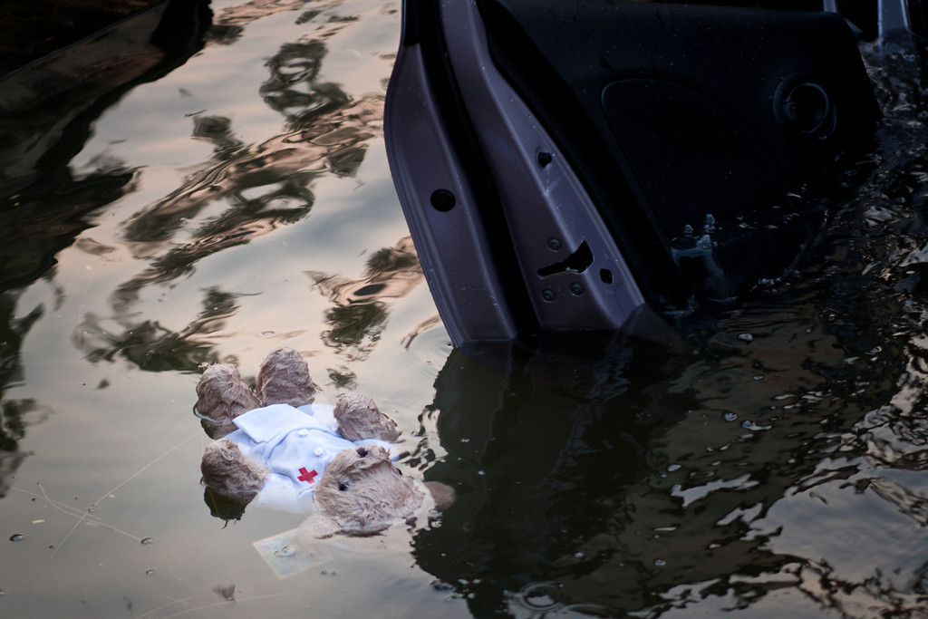 A teddy bear floating in the moat after a car accident in Chiang Mai, Thailand.