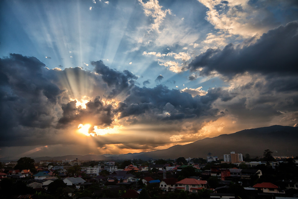 A fiery and beautiful sunset through the clouds over the city of Chiang Mai in Thailand.