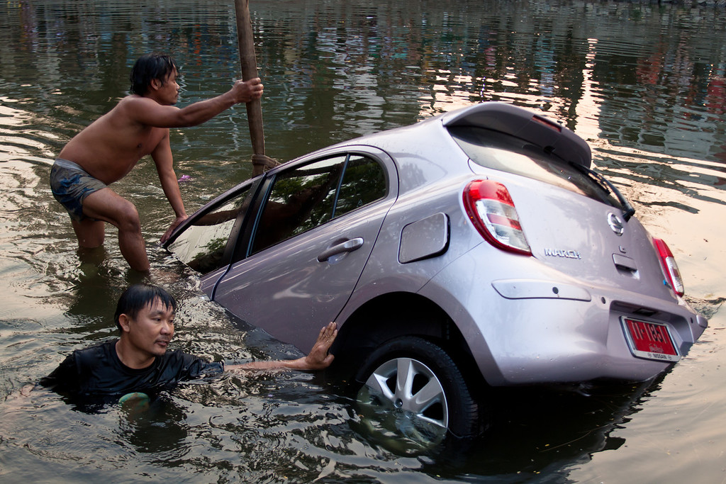 Car in the moat in Chiang Mai, Thailand.