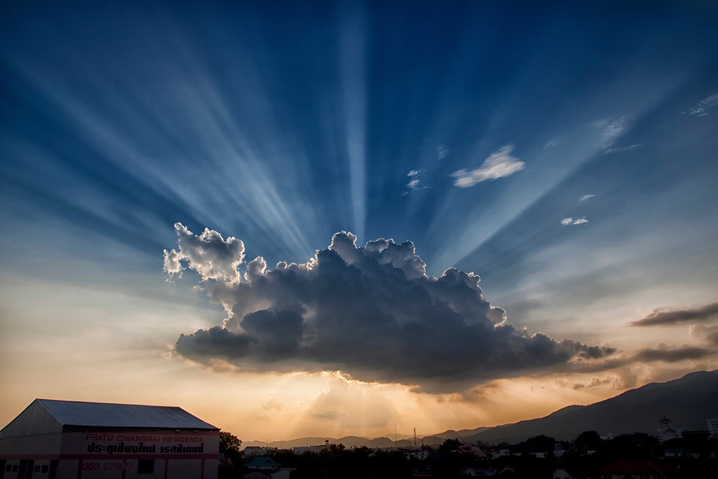 A beautiful sunset behind a cloud in Chiang Mai, Thailand.