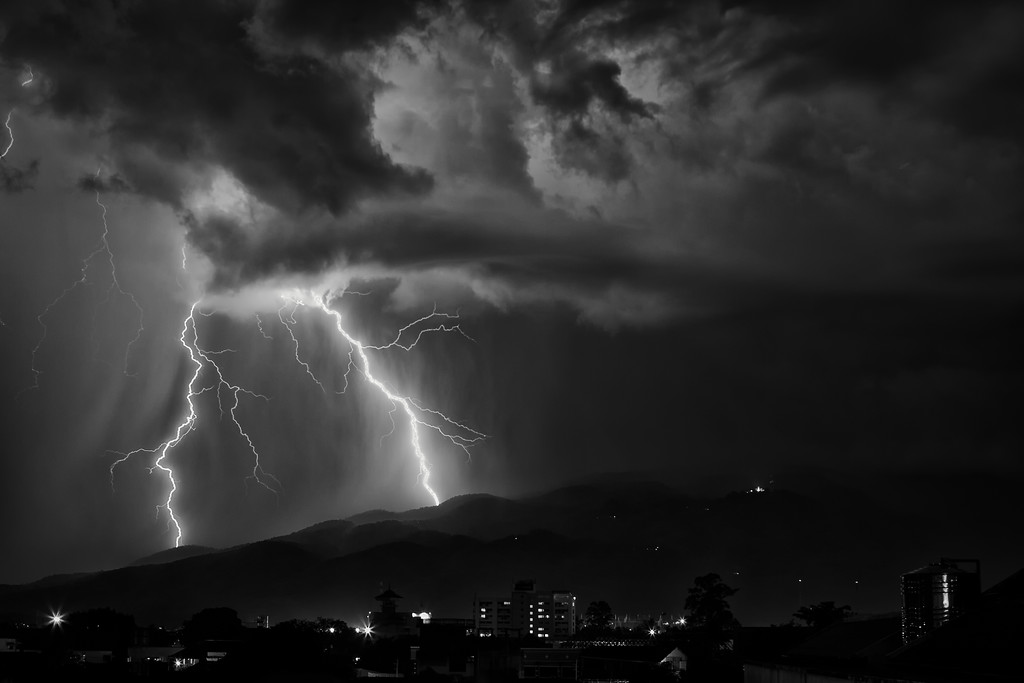 Lightning over Chiang Mai in monochrome.
