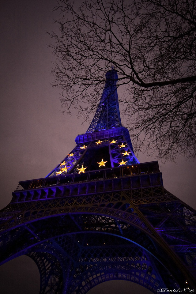 The Eiffel Tower lit in blue with stars representing the CEE in Paris, France.