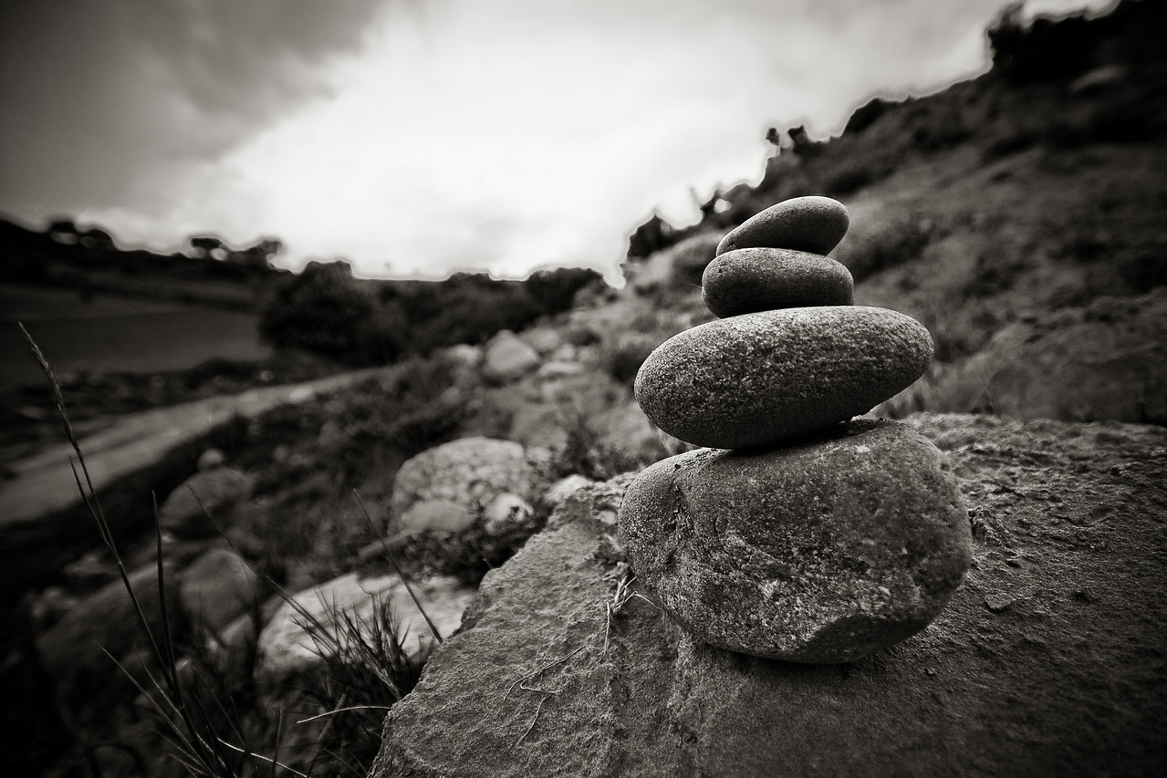 A garden of small pebble cairns on the camino de santiago near ventosa in Spain.