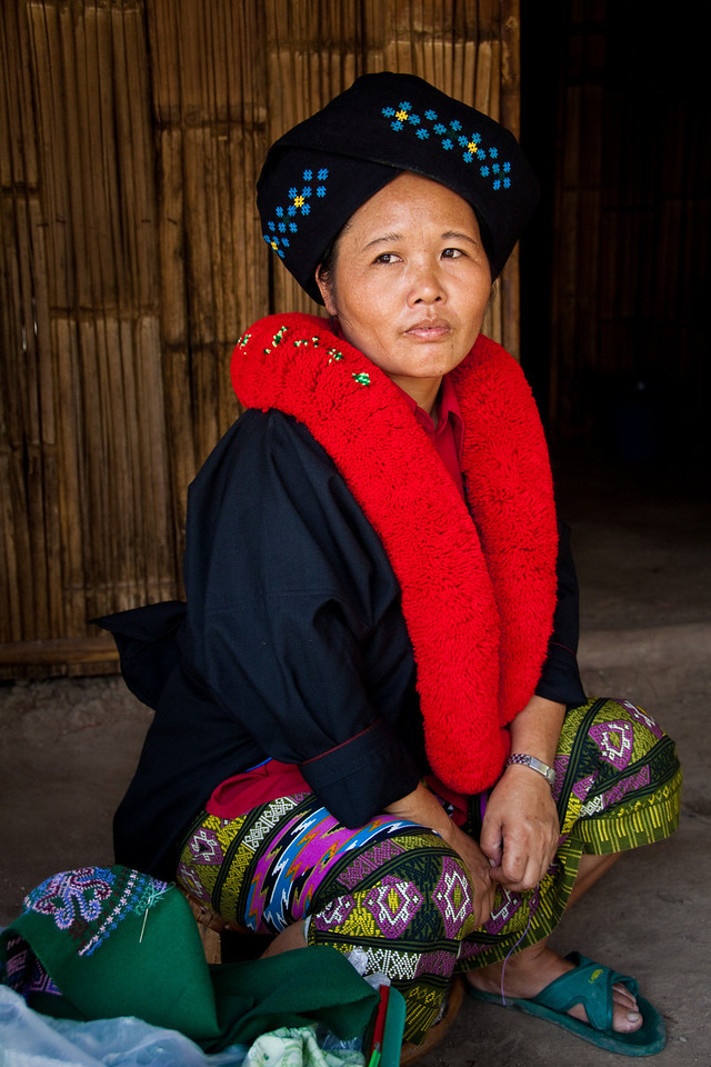 A girl from the Yao hill tribe in Thailand posing in traditional costume in a village near Chiang Mai.