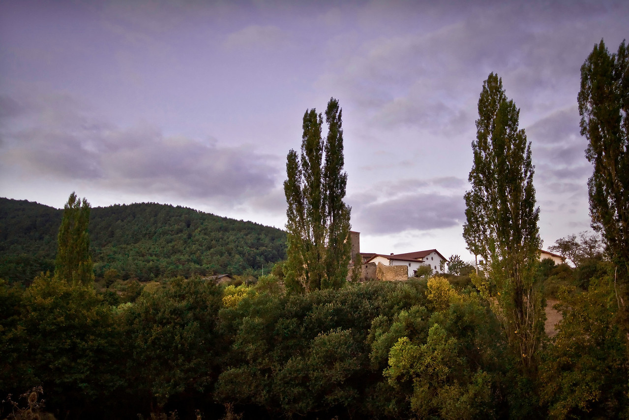 A small village hidden behind trees near the town of Zubiri on the Camino de Santiago in Spain