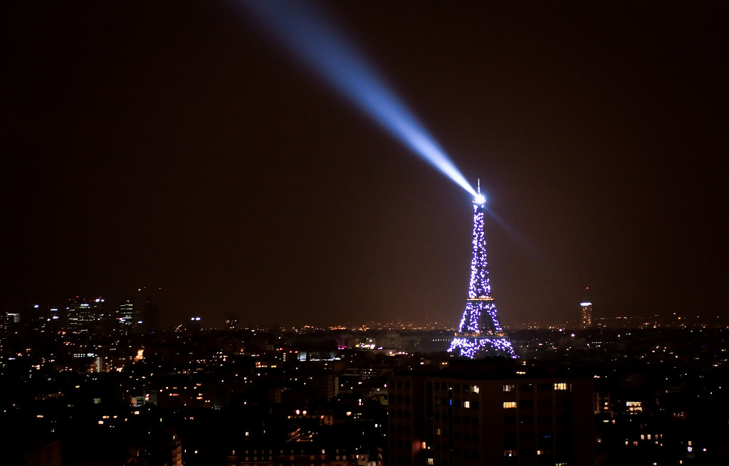 A famous French Icon, the Tour Eiffel, glittering at night every hour overlooking Paris.