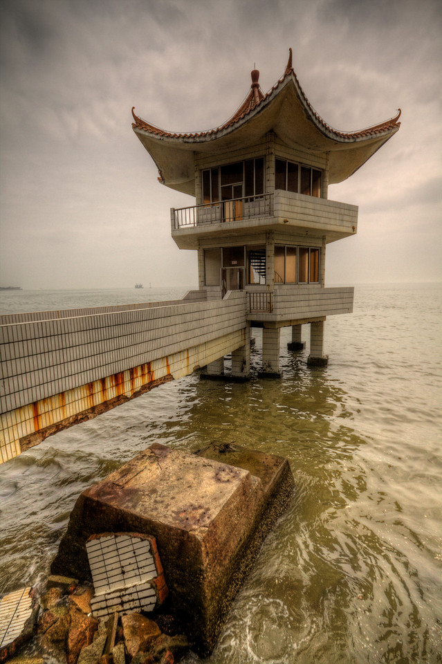 A creepy looking watchtower with Chinese architecture in Zhuhai, China.
