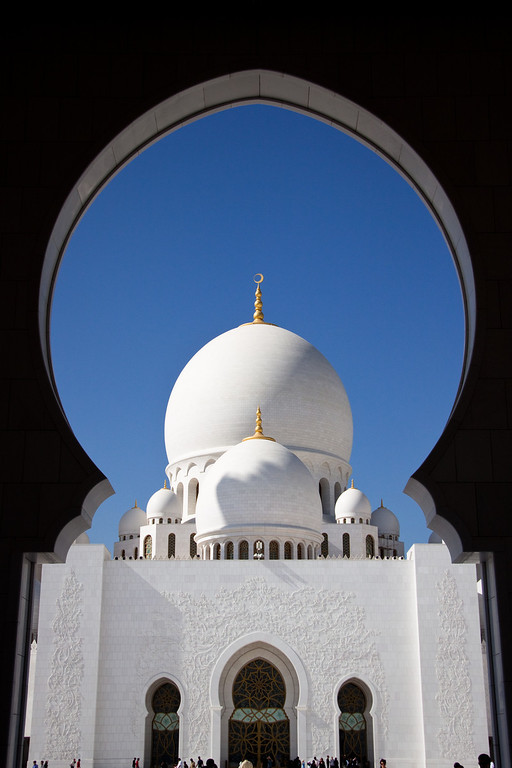 Framed by the arch in Sheikh Zayed Mosque in Abu Dhabi, UAE