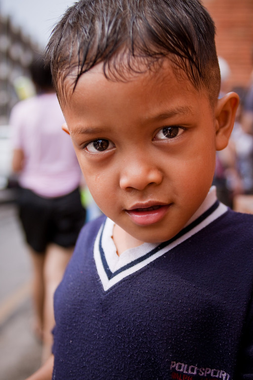 A close up portrait of a little kid during Songkran in Chiang Mai, Thailand
