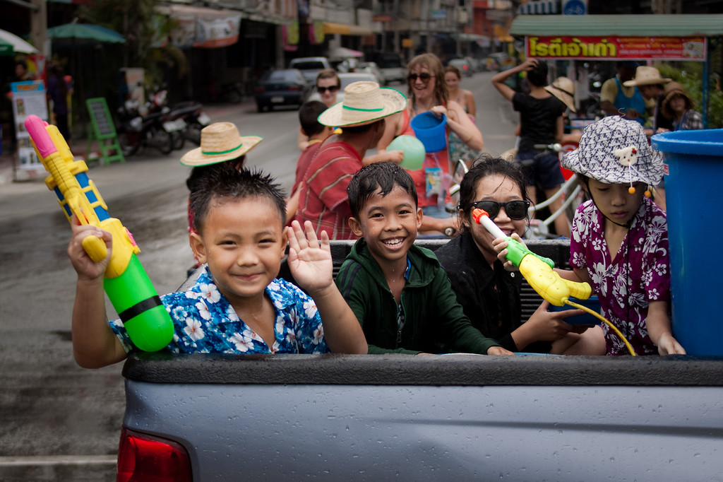 Children during Songkran riding a truck in Chiang Mai, Thailand.