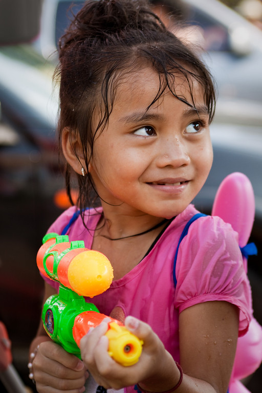 A cute little girl with a watergun during songkran in Chiang Mai, Thailand.