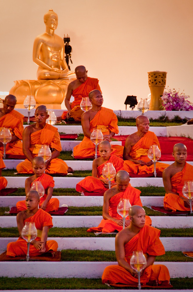 Buddhist Monks waiting to start the Loy Krathong 2010 ceremony by chanting and praying.