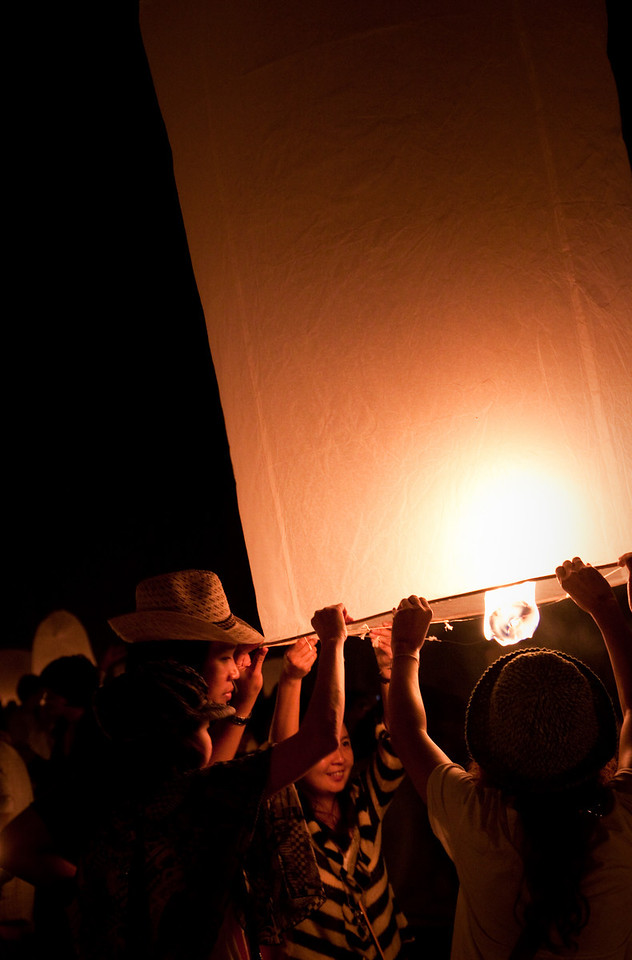 Friends lighting up their lantern in Mae Jo for the Loy Krathong Ceremony 2010