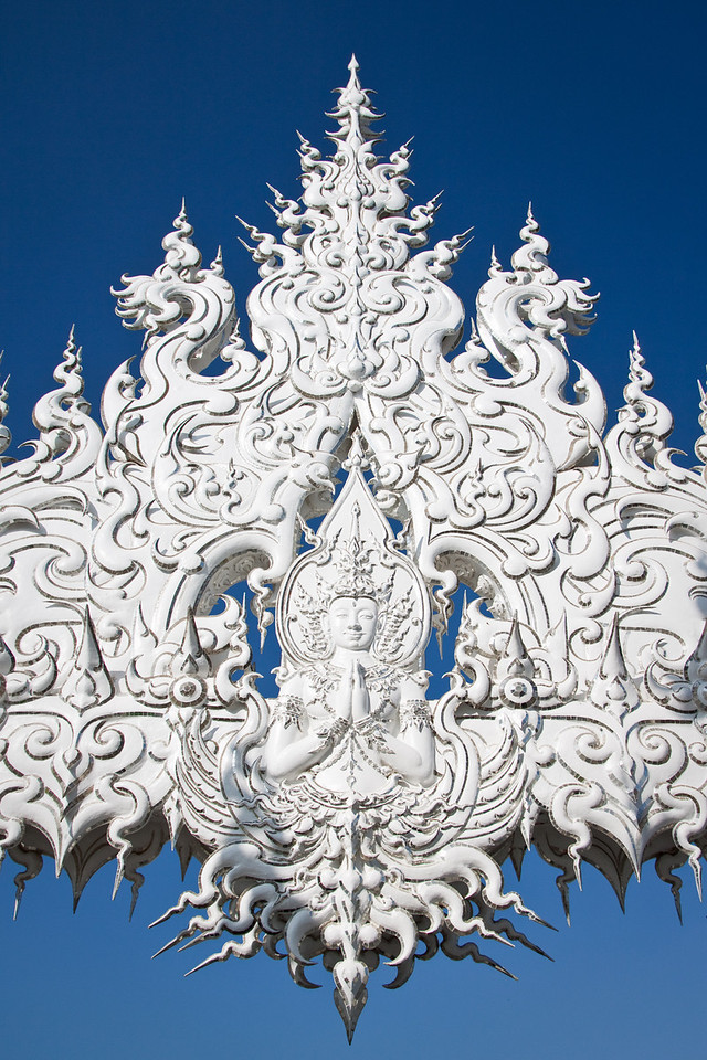 Detailed decorations with a Buddha Statue in the White temple Wat rong khun in Chiang Rai, Thailand
