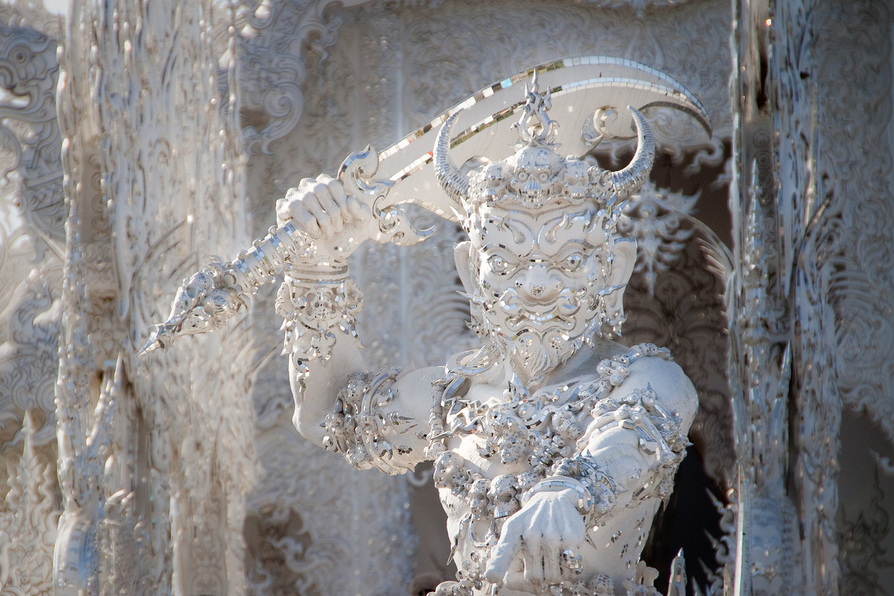Rahu and Death guarding the entrance of the white temple wat rong khun in Chiang Rai, Thailand.