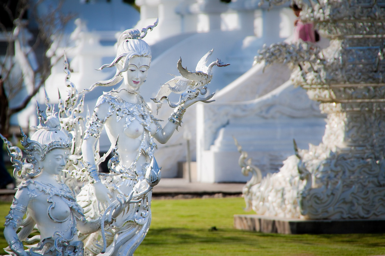 Fantastic creatures from Mythology guard the pond around the white temple wat rong khun in CHiang Rai, Thailand