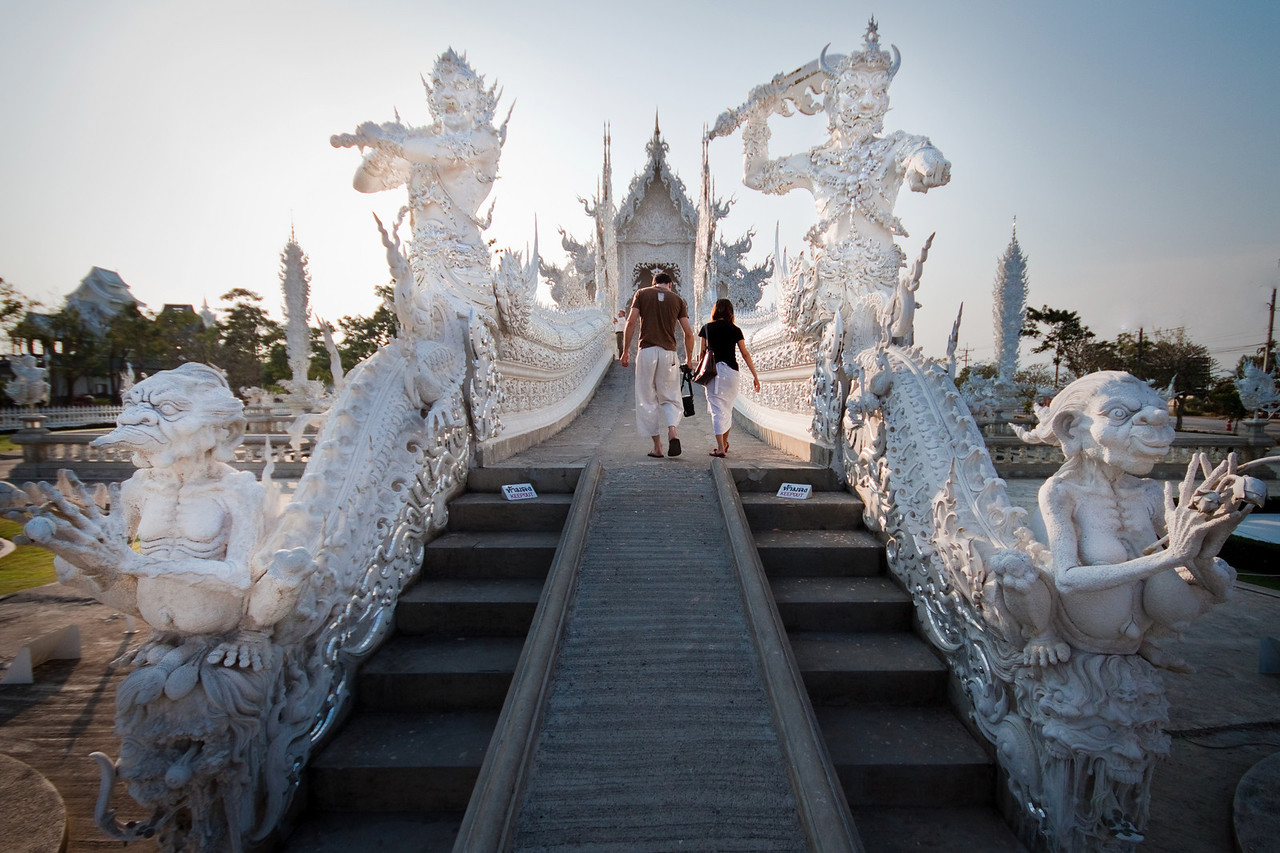 Rahu and Death garding the Gates of Heaven at the entrance of the White Temple Wat Rong Khun in Chiang Rai, Thailand