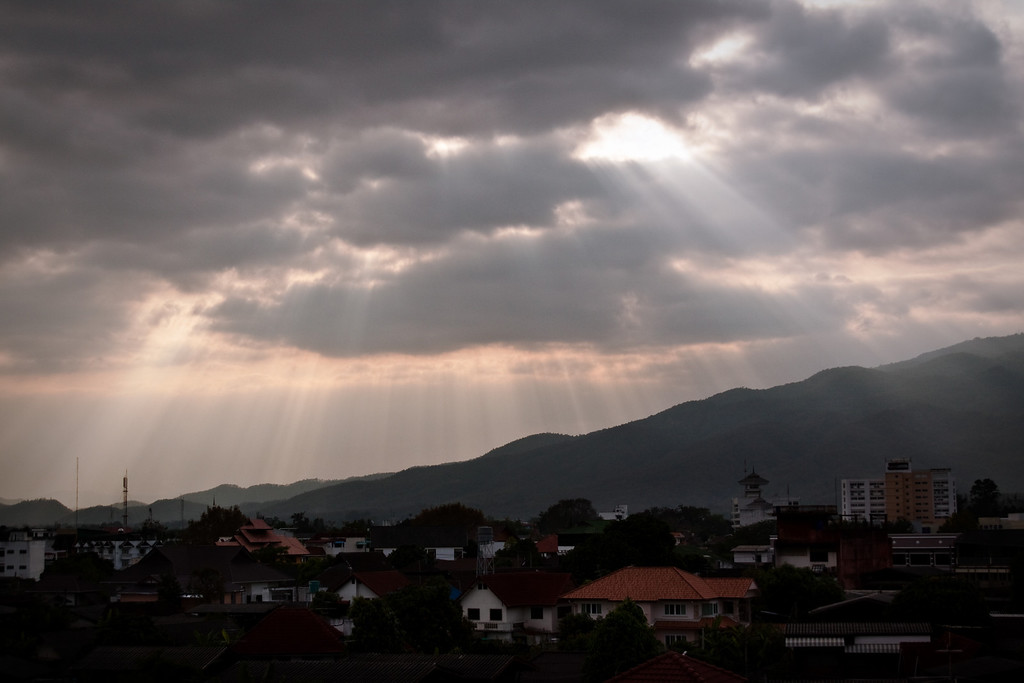 Sun rays through a cloudy sky over Chiang Mai, North of Thailand.
