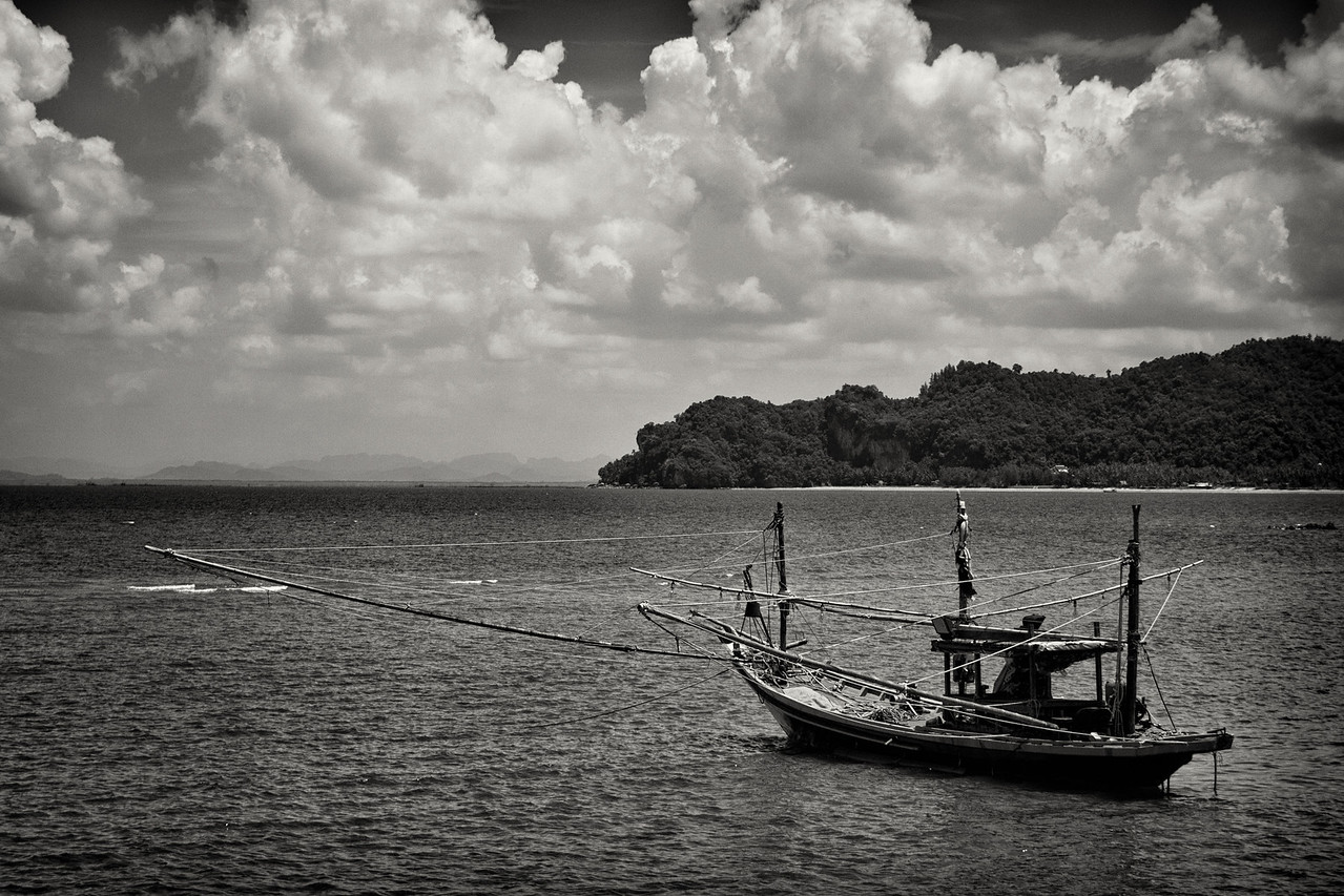 A fishing boat wating for evening in a bay near Chumpon in Thailand.