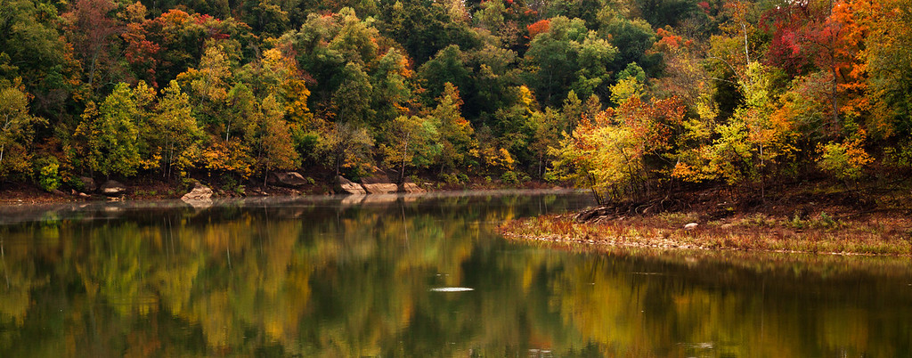 Fall color reflections on Rough River lake in Kentucky, USA