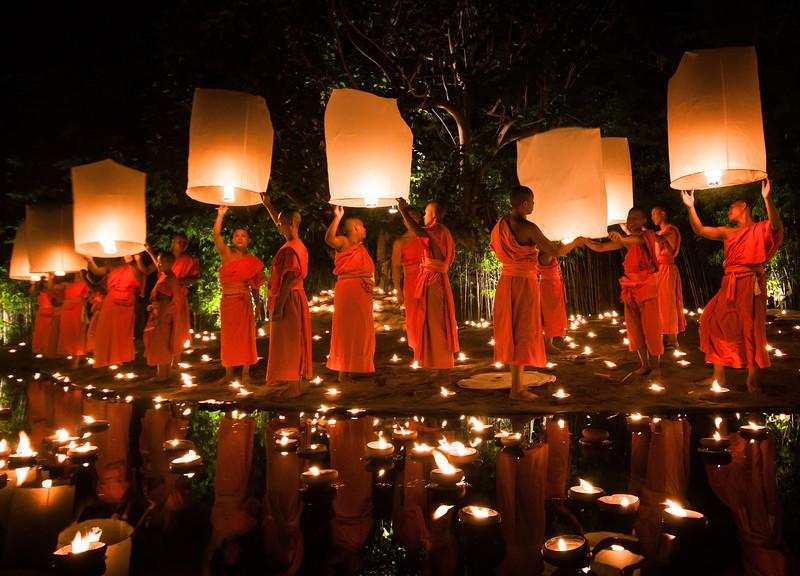 Monks releasing flying lanterns during Loy Krathong in Chiang Mai, Thailand.