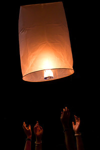 Releasing a flying lantern in Chiang Mai, Thailand.